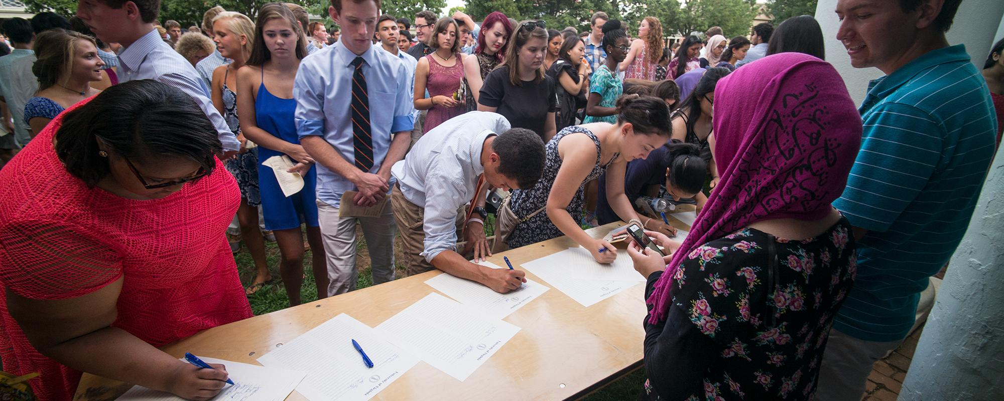 Students signing Honor Scrolls